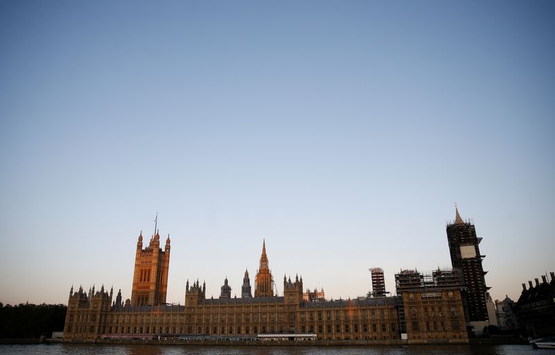 FILE PHOTO: The sun rises over the Houses of Parliament in London