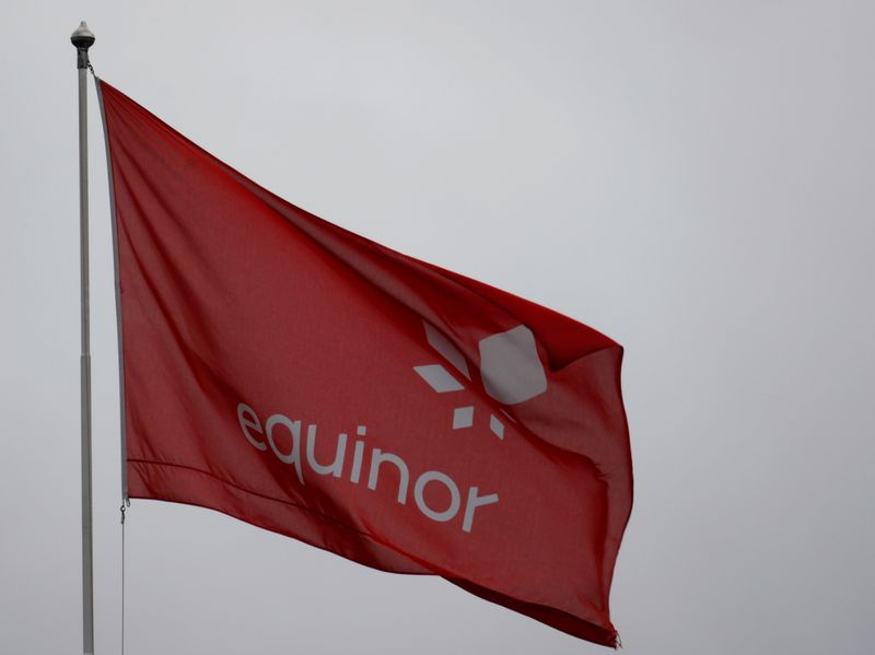 FILE PHOTO: Equinor's flag flutters next to the company's headquarters in Stavanger, Norway
