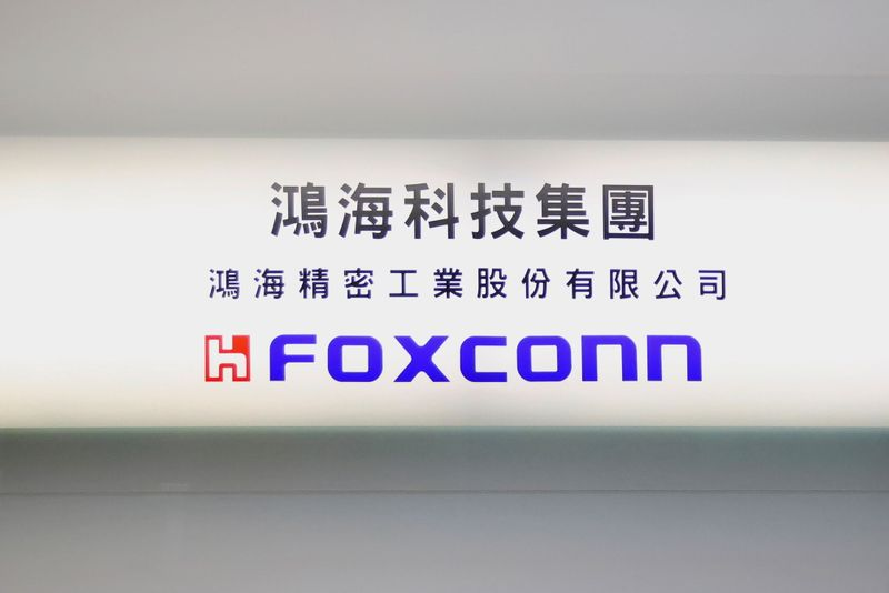 FILE PHOTO: A Foxconn sign is seen on a glass door inside its office building in Taipei