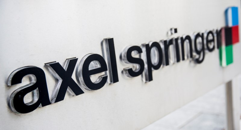 Logo of German publisher Axel Springer is seen outside its headquarters in Berlin