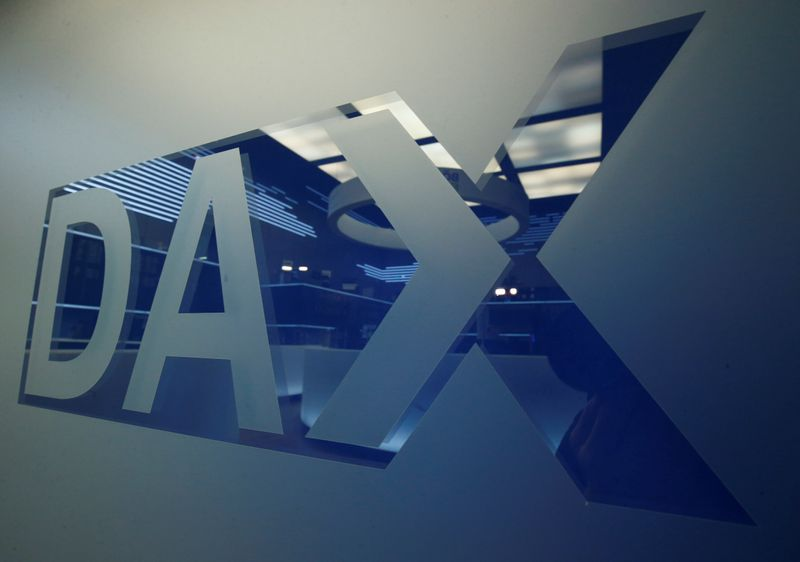 A DAX logo is pictured at the trading floor of the stock exchange in Frankfurt