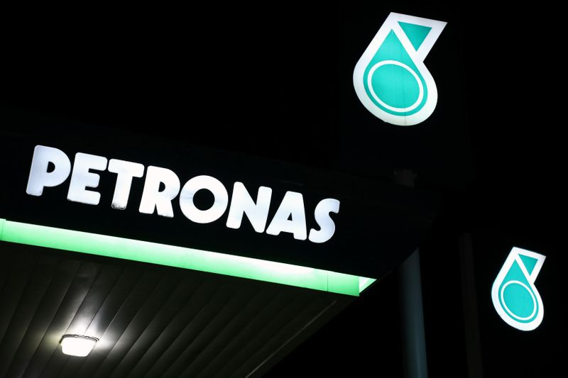 Petronas logos are pictured at a fuel station in Kuala Lumpur