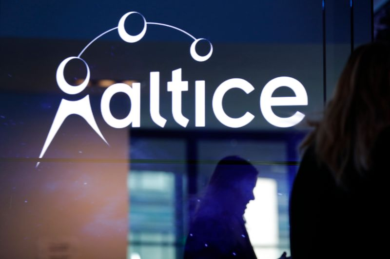 FILE PHOTO: The logo of cable and mobile telecoms company Altice Group is seen during a news conference in Paris