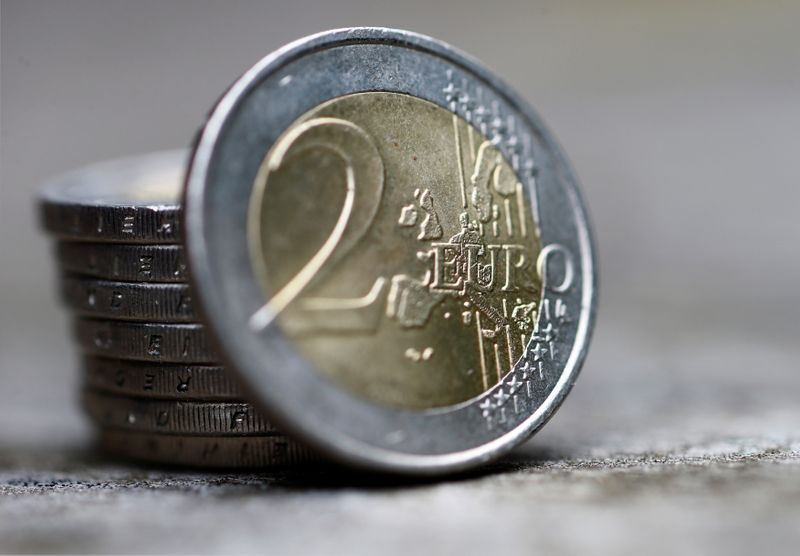 A pile of two Euro coins is pictured in an illustration.