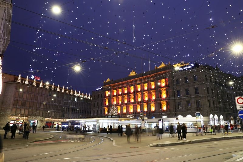 FILE PHOTO: Christmas illuminations are seen on the buildings of Swiss banks UBS and Credit Suisse in Zurich