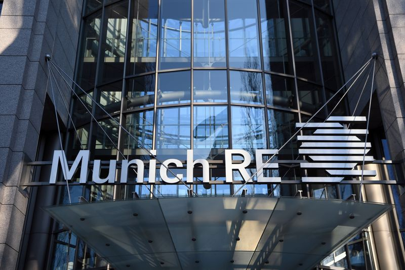 FILE PHOTO: The logo of reinsurance company Munich Re Group is seen next to the entrance of their headquarters in Munich