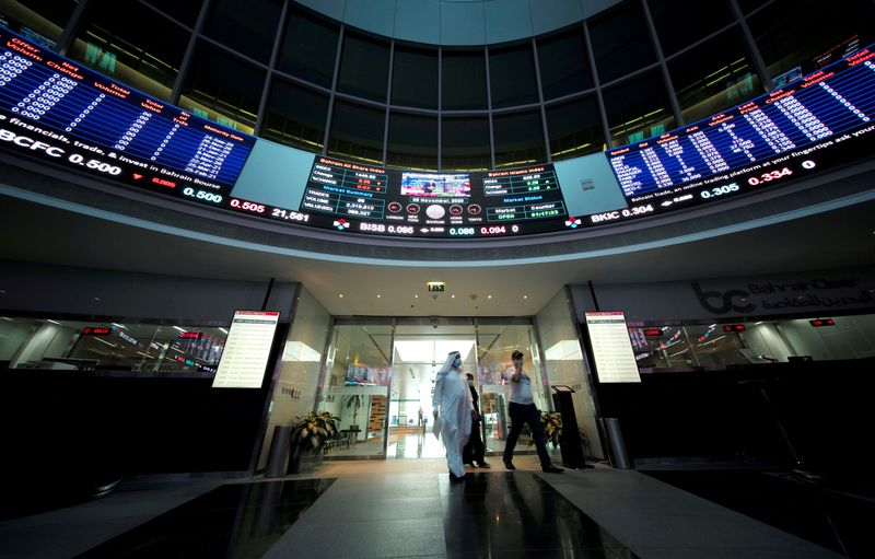 FILE PHOTO: Bahraini traders are pictured in Bahrain Bourse in Manama, Bahrain