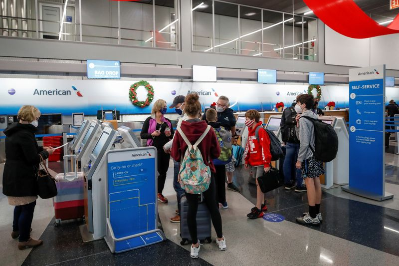 FILE PHOTO: Travelers at O'Hare International Airport ahead of the Thanksgiving holiday in Chicago