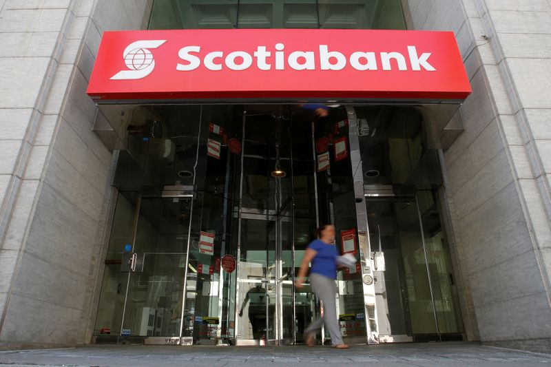 FILE PHOTO: A woman leaves a Scotiabank branch in Ottawa