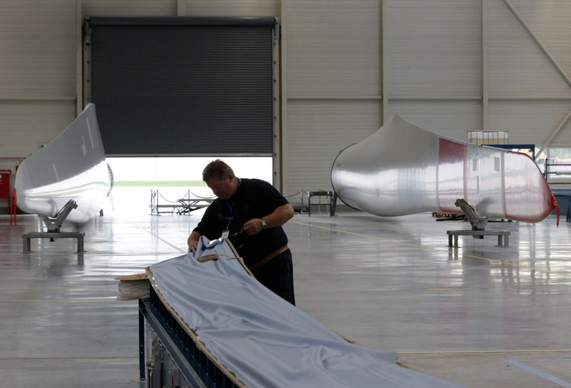FILE PHOTO: Engineer works at the Nordex wind turbine factory hall in Rostock