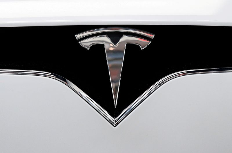 FILE PHOTO: The Tesla logo is seen on a car at Tesla's showroom in Manhattan's Meatpacking District in New York