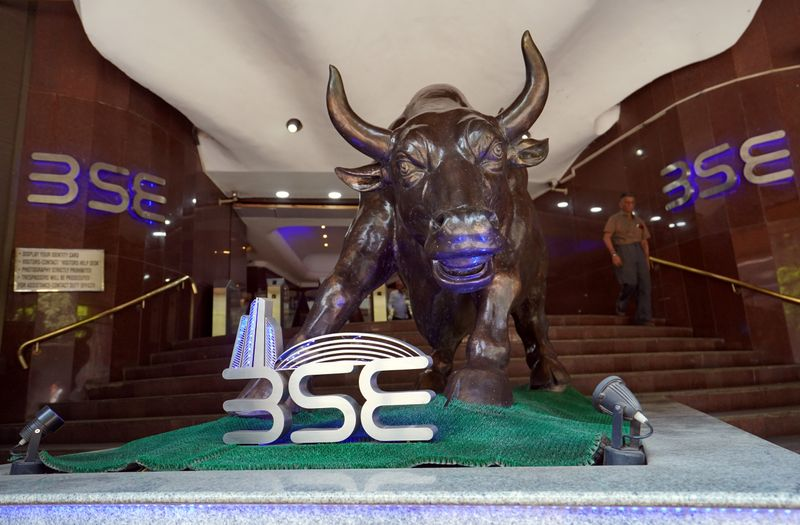 FILE PHOTO: A man walks out of the Bombay Stock Exchange building in Mumbai, India