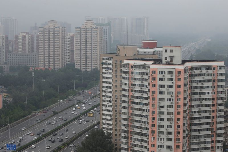 FILE PHOTO: Residential buildings are seen along the Fourth Ring Road in Beijing