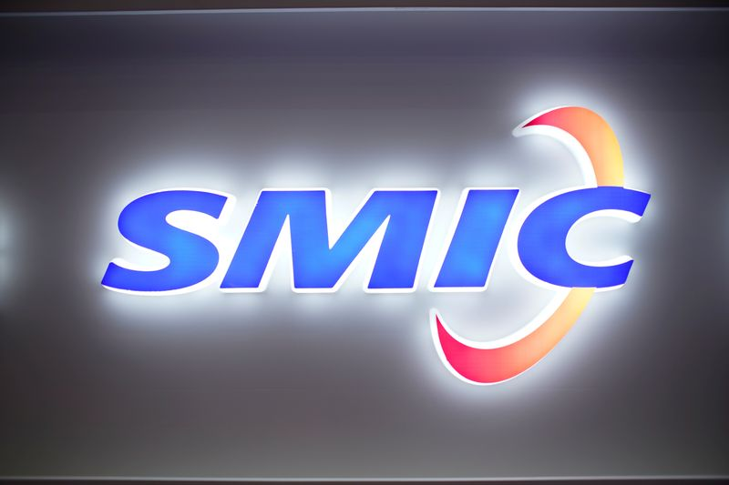 FILE PHOTO: A logo of Semiconductor Manufacturing International Corporation (SMIC) is seen at China International Semiconductor Expo (IC China 2020) following the coronavirus disease (COVID-19) outbreak in Shanghai