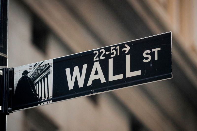 A Wall St. sign is seen near the NYSE in the financial district in New York