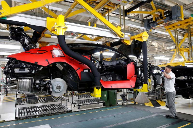 FILE PHOTO: A worker constructs a Bentley Continental GT on the prodution line at the luxury automaker's manufacturing facility in Crewe