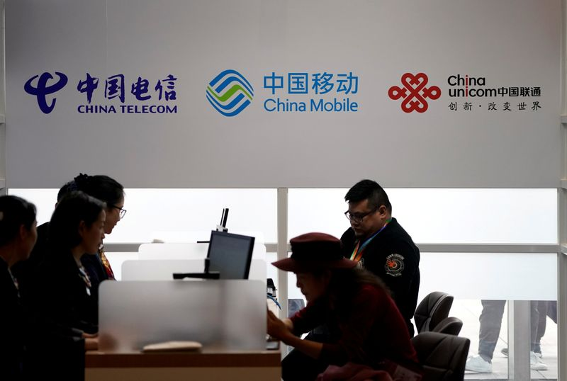 China telecom firms slide after NY delisting as oil giants fret