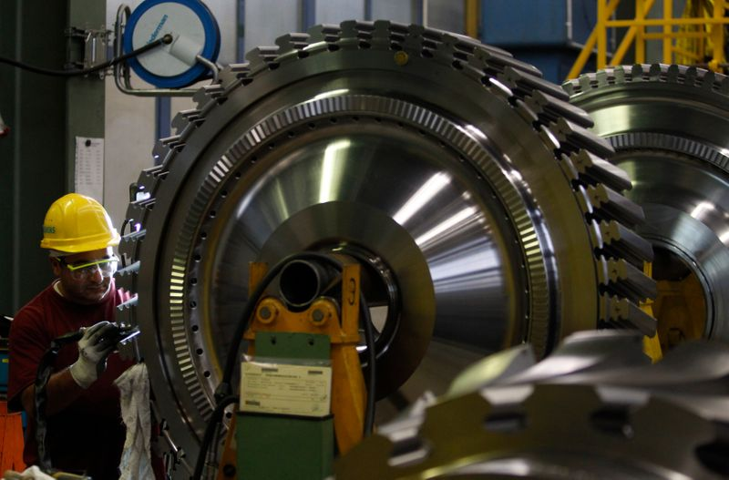 Employee of Siemens AG works on gas turbine in Berlin