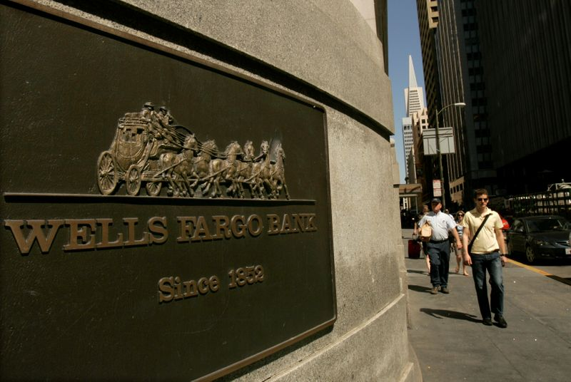 FILE PHOTO: A pedestrian walks past a Wells Fargo & Co bank in San Francisco