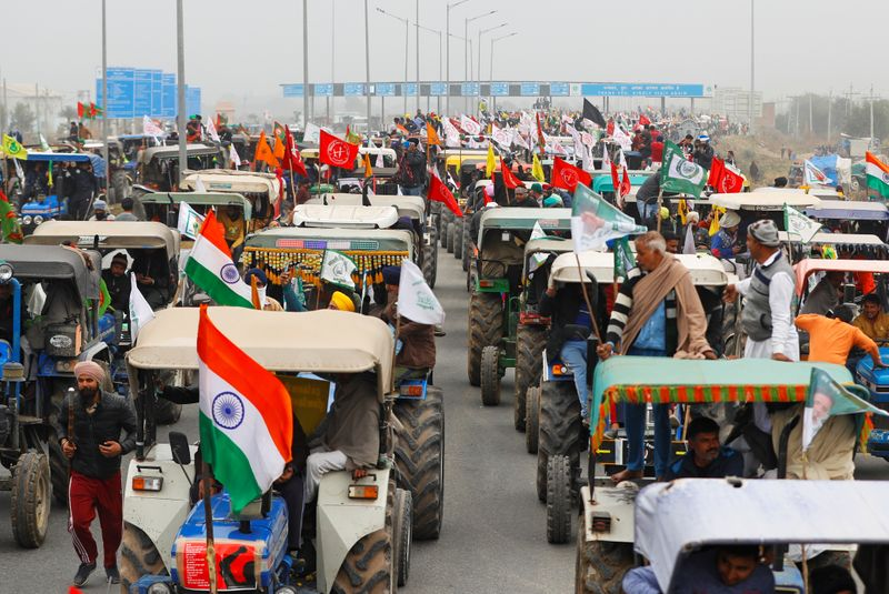 FILE PHOTO: Rally to protest against the newly passed farm bills, on a highway on the outskirts of New Delhi