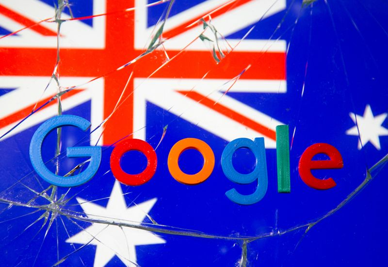 FILE PHOTO: A 3D printed Google logo is placed on broken glass in front of displayed Australian flag  in this illustration taken