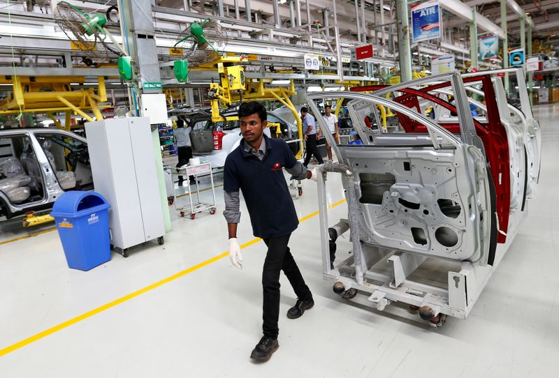 FILE PHOTO: FILE PHOTO: An employee works inside the Mahindra & Mahindra manufacturing plant in Chakan