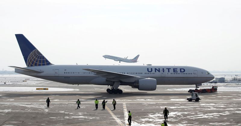 FILE PHOTO: A United Airlines Boeing 777 plane is towed at O'Hare International Airport in Chicago