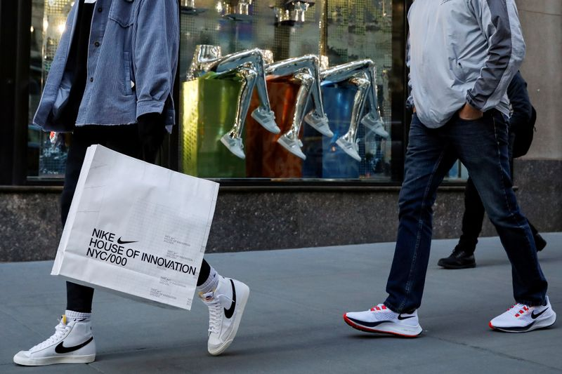 People shop on 5th Avenue in New York
