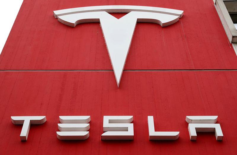 Tesla : Ark adds $171 million Tesla shares as short bets on ETF soar