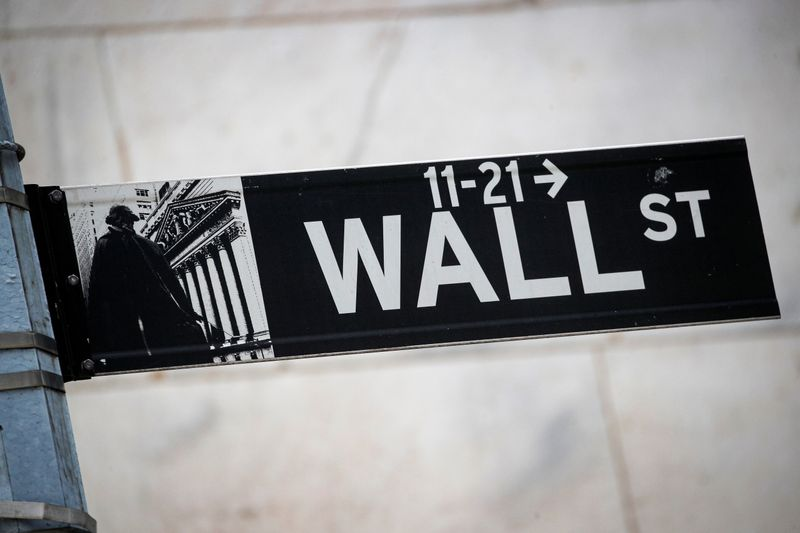 The Wall St. sign is seen outside the NYSE in New York