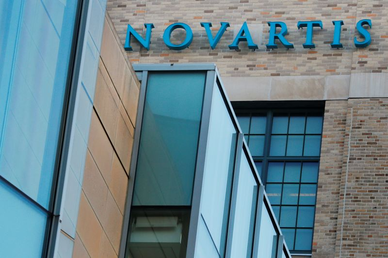 FILE PHOTO: A sign marks Novartis' Institutes for Biomedical Research in Cambridge