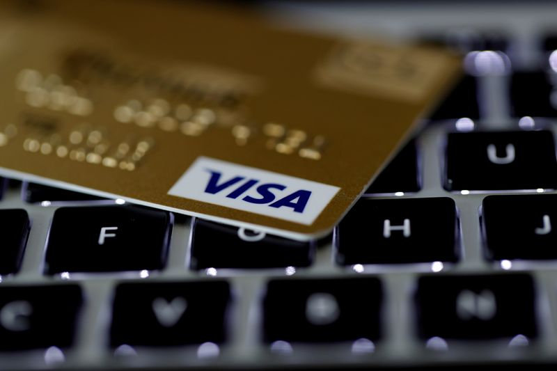 FILE PHOTO: FILE PHOTO: A Visa credit card is seen on a computer keyboard in this picture illustration