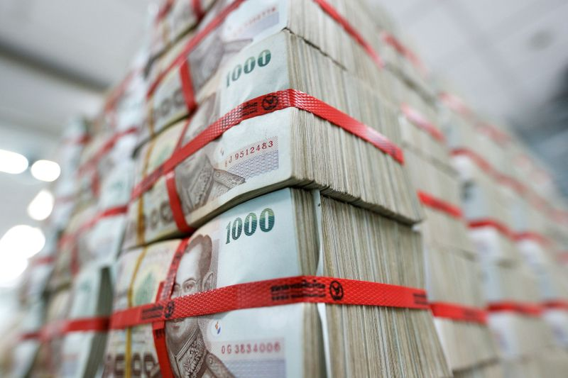 FILE PHOTO: Thai baht notes are seen at a Kasikornbank in Bangkok