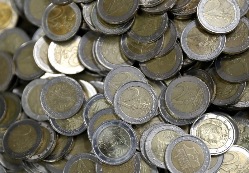 Two Euro coins are seen at the Money Service Austria company's headquarters in Vienna