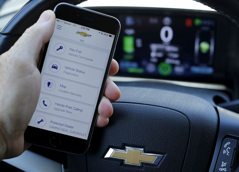 FILE PHOTO: A mobile phone displays the OnStar app inside a Chevrolet Volt vehicle in this photo illustration taken in Encinitas