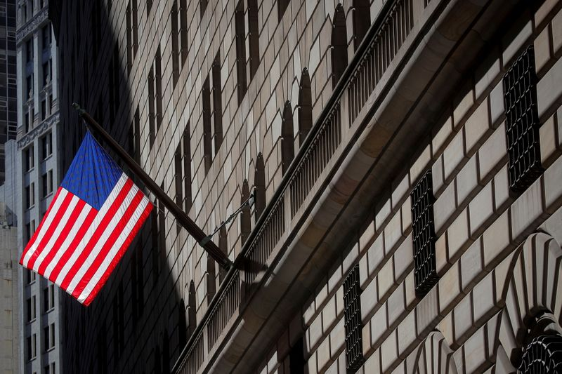 A U.S. flag flies outside The Federal Reserve Bank of New York in New York