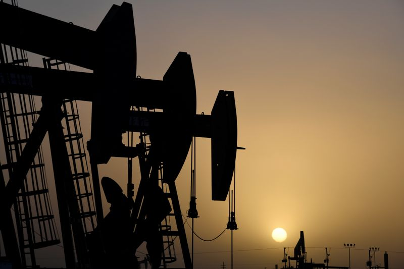 FILE PHOTO: Pump jacks operate at sunset in Midland