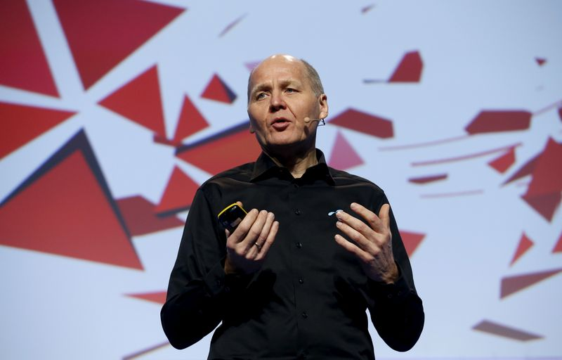 FILE PHOTO: Sigve Brekke, President and CEO of Telenor, delivers a keynote speech during the Mobile World Congress in Barcelona