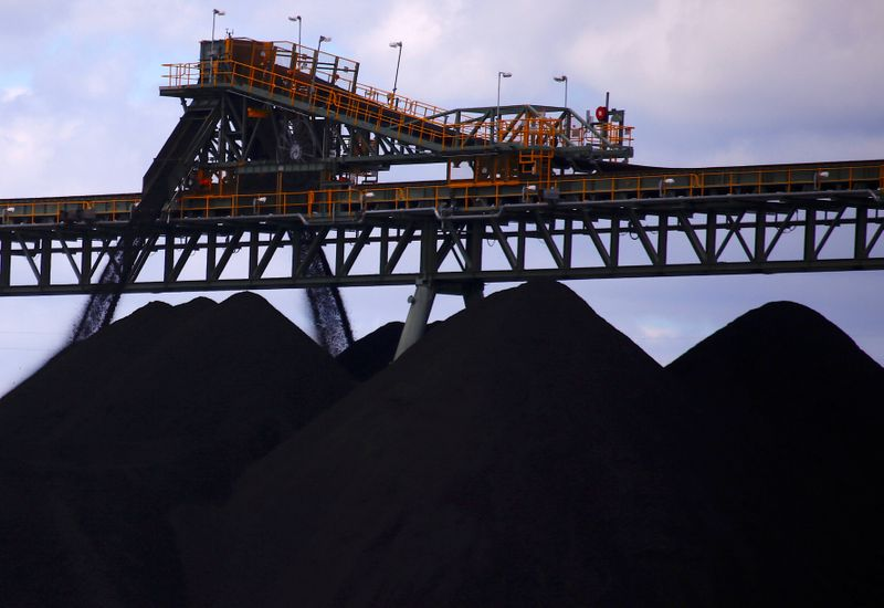 Coal is unloaded onto large piles at the Ulan Coal mines near the central New South Wales rural town of Mudgee