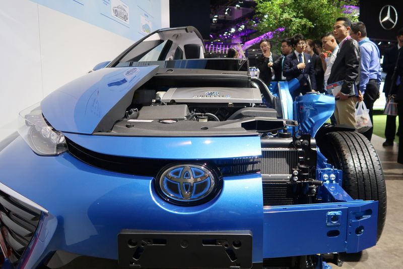 Visitors look at a display of Toyota's Mirai hydrogen fuel-cell vehicle during the second China International Import Expo (CIIE) in Shanghai