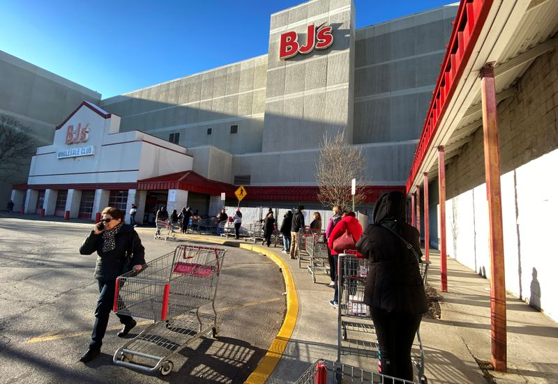 FILE PHOTO: A line of shoppers wait to enter BJ's Wholesale Club market at the Palisades Center shopping mall in West Nyack