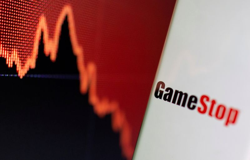 FILE PHOTO: FILE PHOTO: GameStop logo is seen near displayed stock graph in this illustration