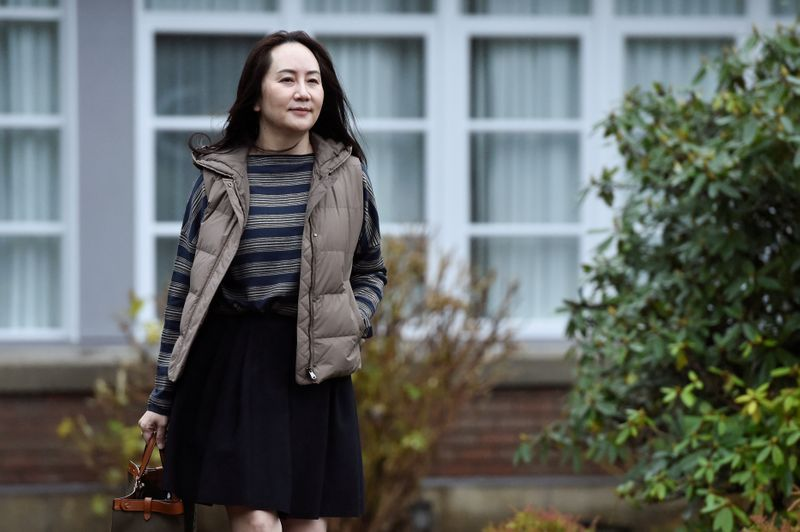 FILE PHOTO: Huawei Technologies CFO Meng Wanzhou leaves her home to attend a court hearing in Vancouver