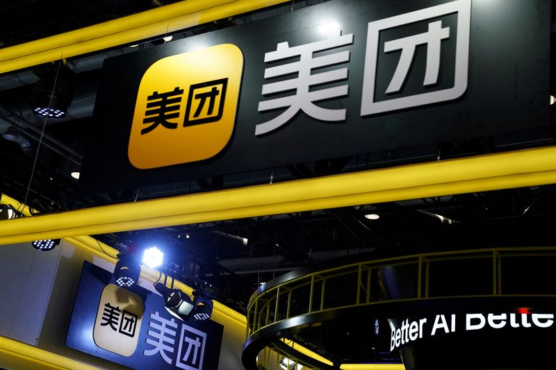 FILE PHOTO: Signs of Meituan are seen at its booth at the 2020 China International Fair for Trade in Services in Beijing