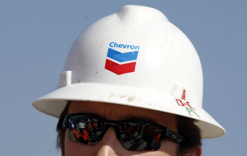 FILE PHOTO: Journalists are reflected in the sunglasses of drilling site manager Murphy during a media day at Chevron's site in Pungesti