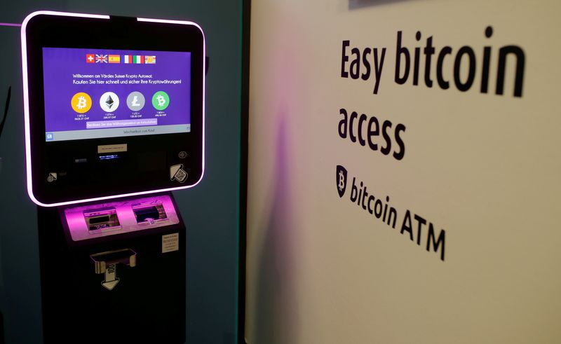 The exchange rates of Bitcoin, Ether, Litecoin and Bitcoin Cash are seen on the display of a cryptocurrency ATM at the headquarters of Swiss Falcon Private Bank in Zurich