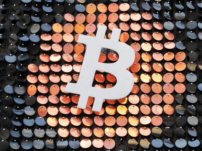 FILE PHOTO: FILE PHOTO: FILE PHOTO: The logo of the Bitcoin digital currency is seen in a shop in Marseille