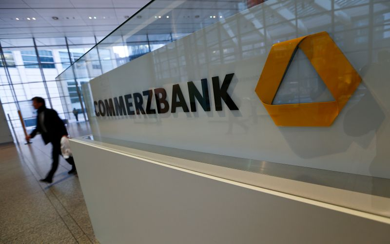 A man walks past a logo of Commerzbank ahead of the bank's annual news conference in Frankfurt