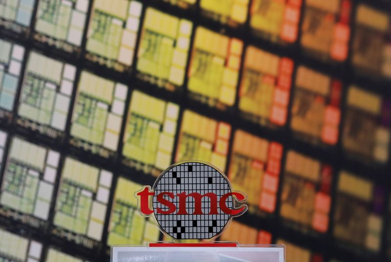 FILE PHOTO: FILE PHOTO: A logo of Taiwan Semiconductor Manufacturing Co (TSMC) is seen at its headquarters in Hsinchu
