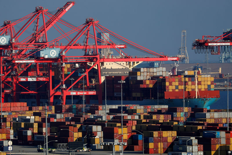 FILE PHOTO: Ships and shipping containers are pictured at the port of Long Beach in Long Beach, California
